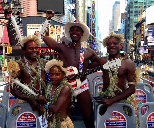 The cast of Tanna do so sightseeing in New York City, accompanied by a street performer. Photo: Tanna Movie
