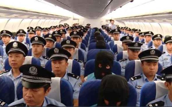 77 alleged members of a Chinese crime syndicate were rounded up by Chinese police and flown from Nadi to China last week. Photo: CCTV